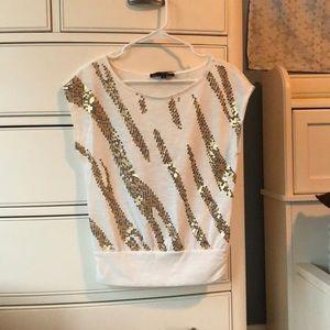 White blouse. No sleeves